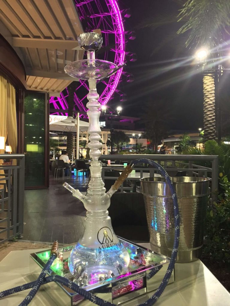 iLounge Istanbul lets you unwind with a cozy atmosphere, a great view of ICON Orlando, a hookah, snacks, and a glass of wine.