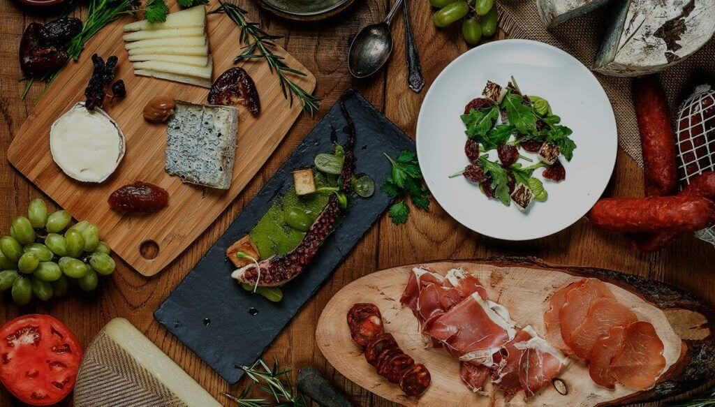 Tapa Toro bring the taste of Spain to the table with various types of jamon, cheese, fruits, and vegetables paired with wine.