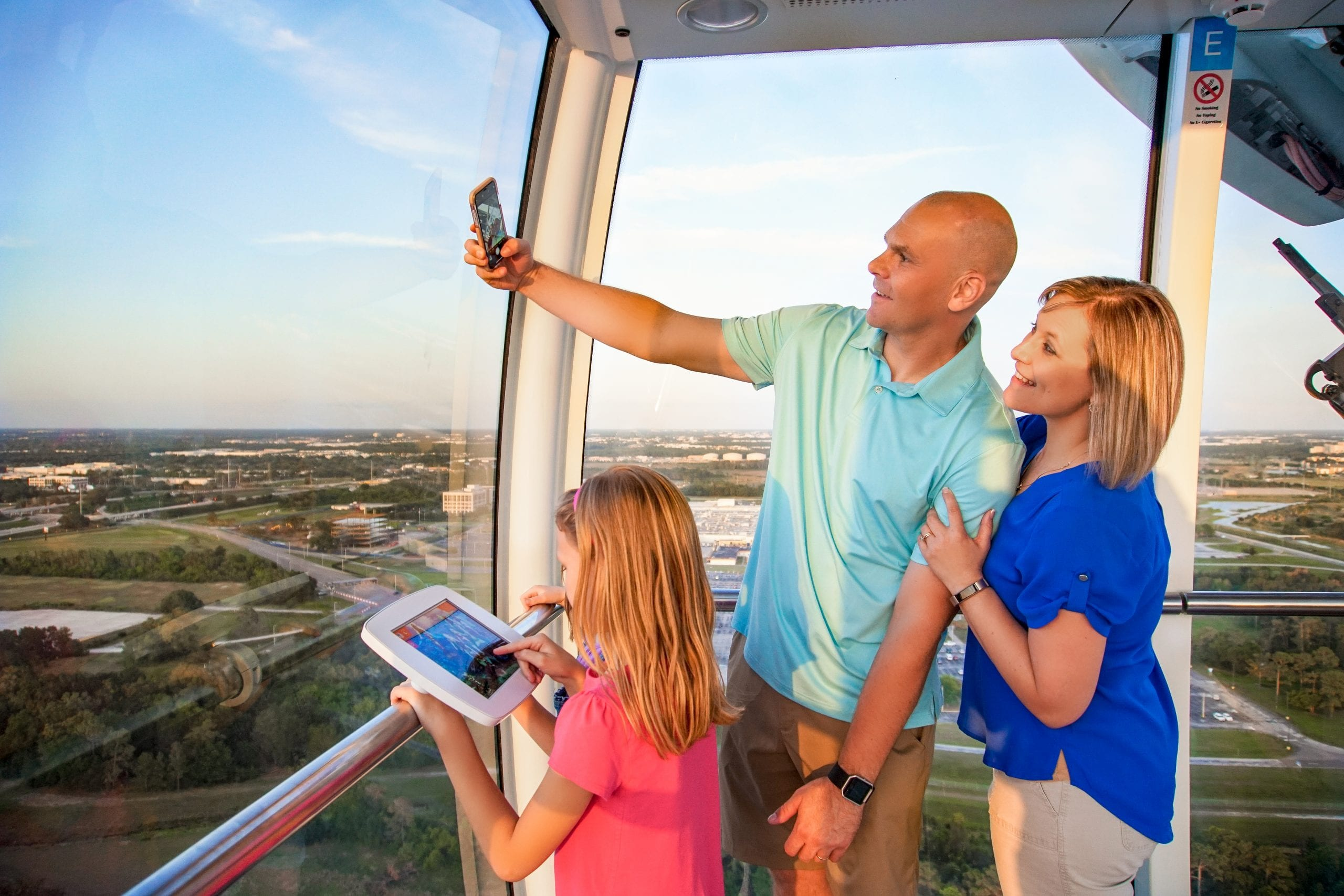 Family taking selfie on The Wheel capsule
