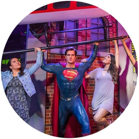 Superman and guests lifting helicopter at Madame Tussauds