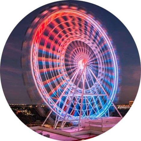 Night time view of The Wheel