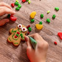 the gingerbread man on a wooden table. the concept of preparation for Christmas