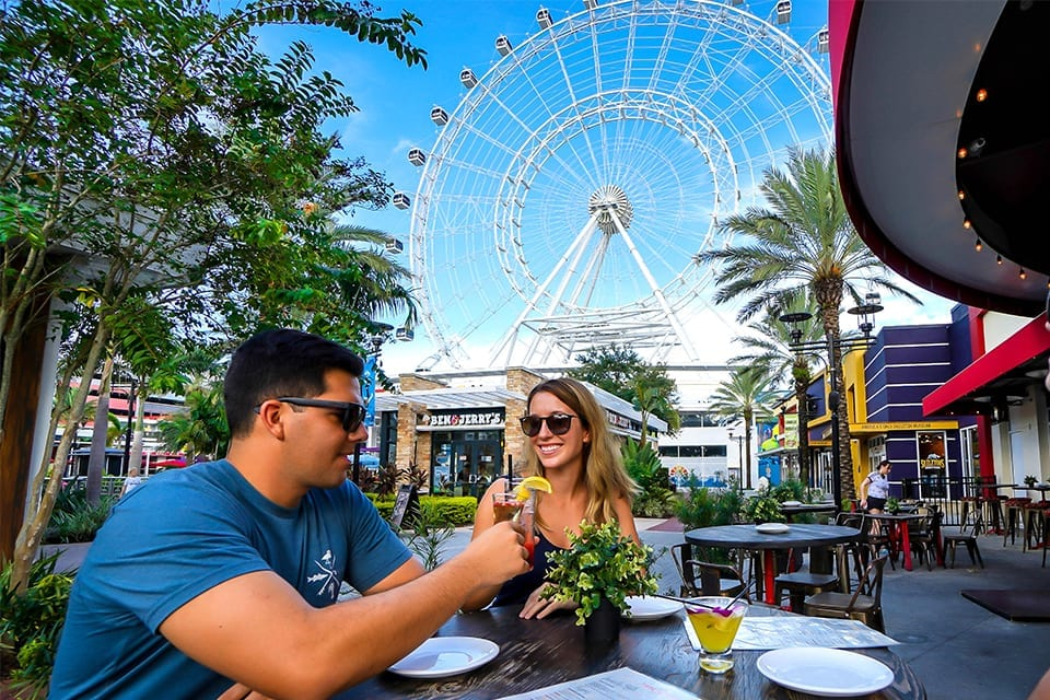 Couples dining by The Wheel