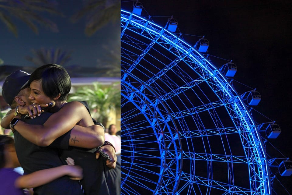 Couple hugging after Wheel turns Blue for Boy